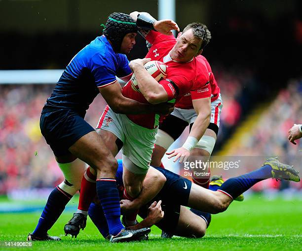 Wales prop Matthew Rees is tackled by Thierry Dusautoir of France during the RBS Six Nations match between Wales and France at the Millennium stadium...
