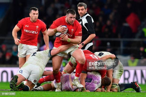 Wales' prop Rob Evans is tackled during the Six Nations international rugby union match between England and Wales at the Twickenham, west London, on...
