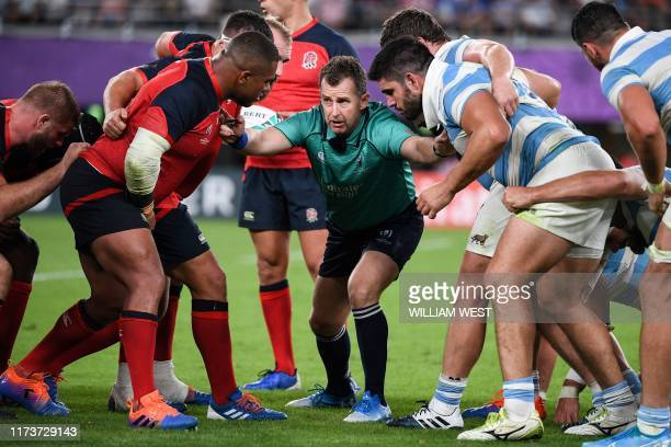 Wales referee Nigel Owens sets players for a scrum during the Japan 2019 Rugby World Cup Pool C match between England and Argentina at the Tokyo...
