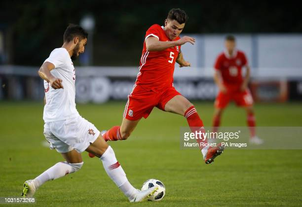 Wales' Regan Poole battles for the ball with Portugal's Jorge Fernandes during the UEFA Euro Under 21 qualifying group eight match at Bangor...