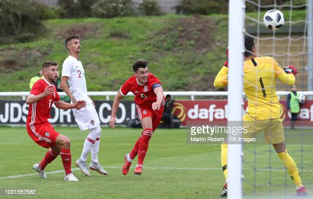 Wales' Regan Poole heads against the bar against Portugal during the UEFA Euro Under 21 qualifying group eight match at Bangor University Stadium...