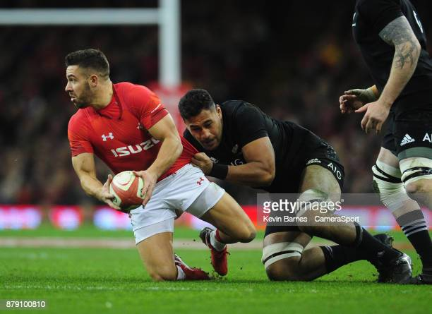 Wales' Rhys Webb is tackled by New Zealand's Patrick Tuipulotu during the 2017 Under Armour Series Autumn International match between Wales and New...