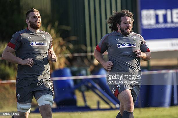 Wales Rugby lock Jake Ball and prop Adam Rhys Jones warm up during a training session two days ahead of their match against South Africa on June 12,...