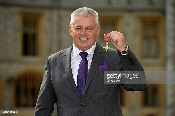 Wales rugby union head coach Warren Gatland poses after being made an OBE for his services to Rugby during an Investiture ceremony on October 2 2014...