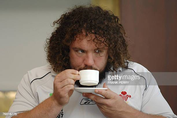 Wales rugby union national team prop Adam Jones has a cup of coffee during a press conference at the Hall Town of Saint-Nazaire, western France, 05...