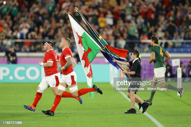 Wales runs onto the field during the Rugby World Cup 2019 Semi-Final match between Wales and South Africa at International Stadium Yokohama on...