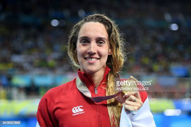 Wales 's Alys Thomas poses with her gold medal after winning the swimming women's 200m butterfly final during the 2018 Gold Coast Commonwealth Games...