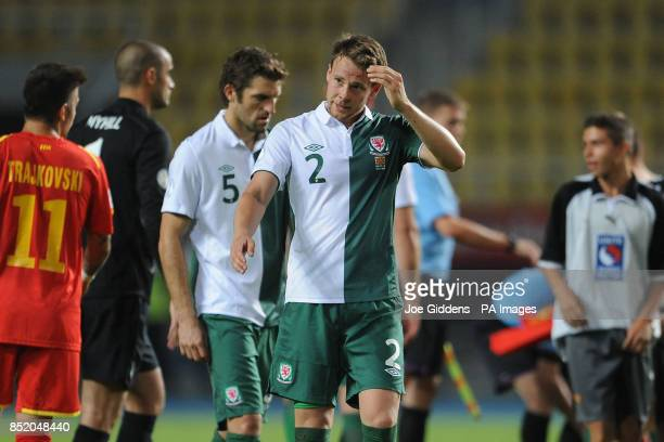 Wales' Sam Ricketts and Chris Gunter stand dejected after the World Cup Qualifying Group A match at the Phillip II Arena Skopje Macedonia