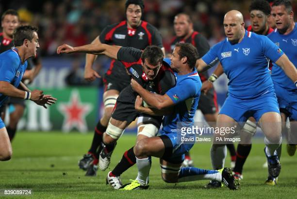 Wales' Sam Warburton is tackled by Namibia's Danie Dames