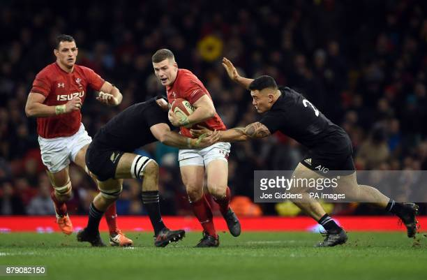 Wales' Scott Williams is tackled by New Zealand's New Zealand's Sam Whitelock and Codie Taylor during the Autumn International at the Principality...