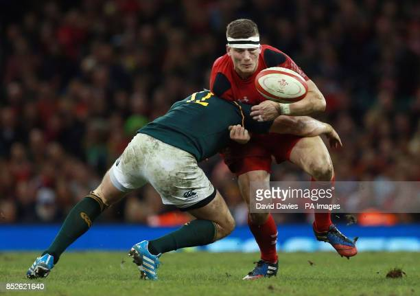 Wales Scott Williams loses the ball in the tackle of tackle of South Africa's Jean de Villiers during the Dove Men Series match at the Millennium...