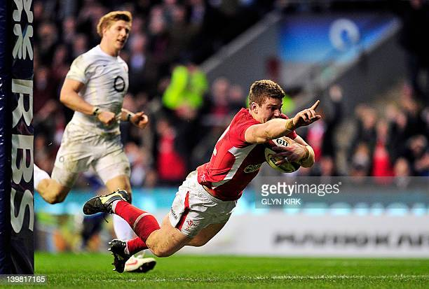 Wales' Scott Williams scores a try during the 6 Nations International rugby union match between England and Wales at Twickenham Stadium southwest of...