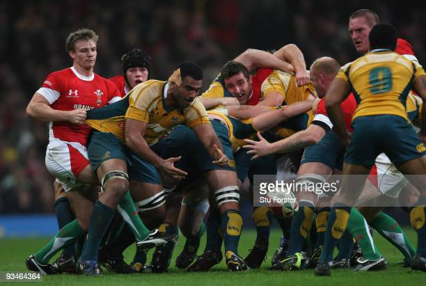 Wales scrum half Dwayne Peel pulls back Wycliff Palu of Australia during the Invesco Perpetual match between Wales and Australia at Millennium...