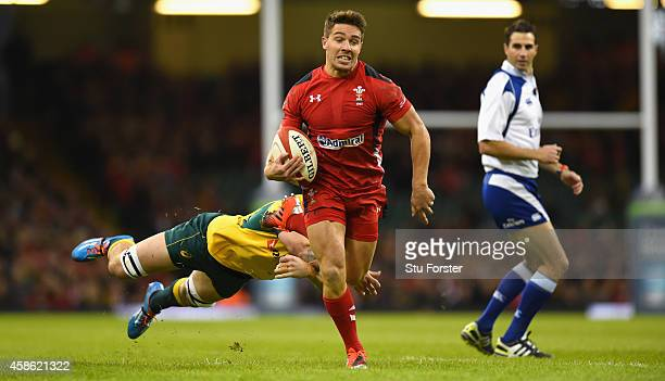 Wales scrum half Rhys Webb breaks through to score the first try during the Autumn international match between Wales and Australia at Millennium...