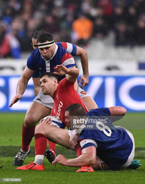 Wales' scrum half Tomos Williams is tackled by France's hooker Guilhem Guirado and France's number eight Louis Picamoles during the Six Nations rugby...