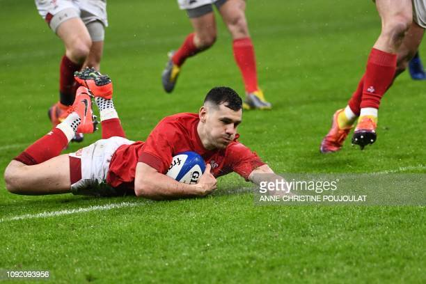 Wales' scrum half Tomos Williams scores a try during the Six Nations rugby union tournament match between France and Wales at the stade de France in...