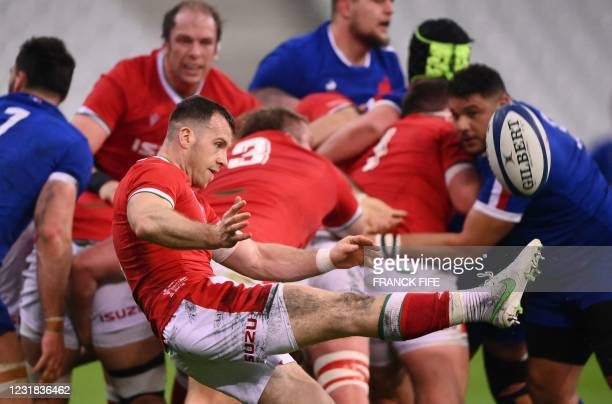 Wales' scrum-half Gareth Davies hits a box kick during the Six Nations rugby union tournament match between France and Wales on March 20 at the Stade...