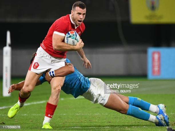 Wales' scrum-half Gareth Davies is tackled during the Japan 2019 Rugby World Cup Pool D match between Wales and Uruguay at the Kumamoto Stadium in...