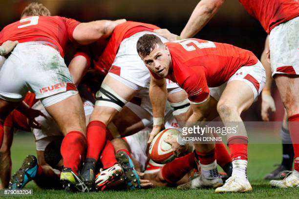 Wales' scrum-half Gareth Davies prepares to release the ball during the Autumn international rugby union Test match between Wales and New Zealand at...