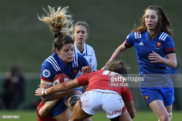Wales' scrumhalf Keira Bevan and Wales' wing Jess KavanaghWilliams tackle France's number 8 Gaelle Hermet during the Women's Six Nations...