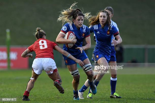 Wales' scrumhalf Keira Bevan tackles France's number 8 Gaelle Hermet during the Women's Six Nations international rugby union match between Wales and...