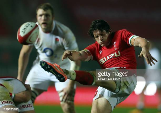 Wales' scrum-half Lloyd Williams kicks during the Autumn Nations Cup international rugby union match between Wales and England at at the Parc y...