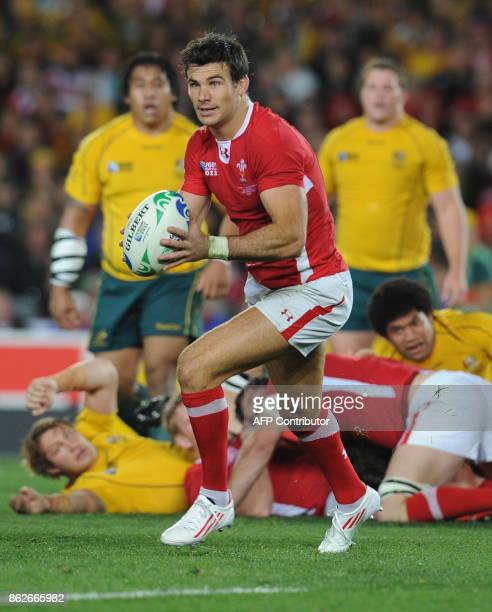 Wales' scrumhalf Michael Phillips prepares to pass the ball during the 2011 Rugby World Cup bronze final match Wales vs Australia at the Eden Park in...