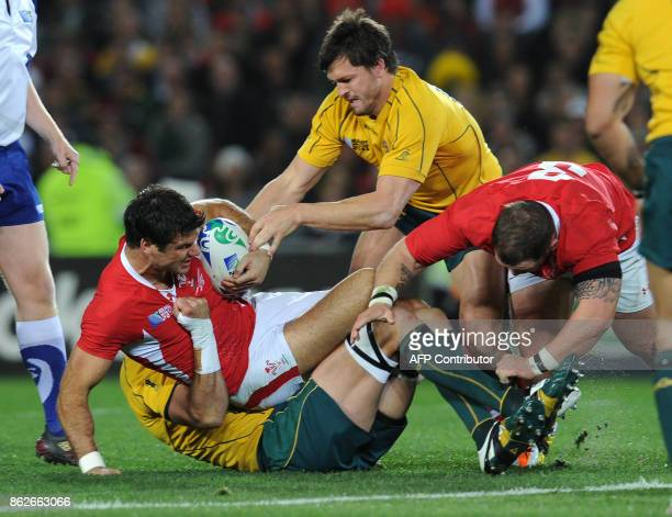 Wales' scrumhalf Michael Phillips vies with Australian Wallabies center Adam AshleyCooper during the 2011 Rugby World Cup bronze final match Wales vs...