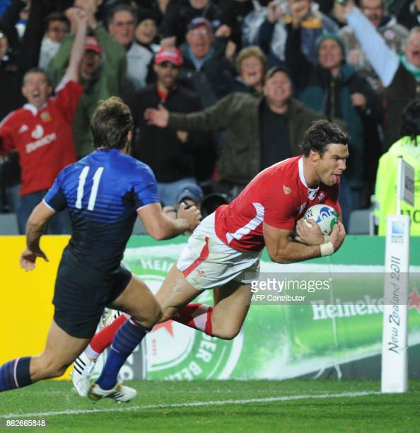 Wales' scrumhalf Mike Phillips scores a try during the 2011 Rugby World Cup semifinal match Wales vs France at the Eden Park in Auckland on October...