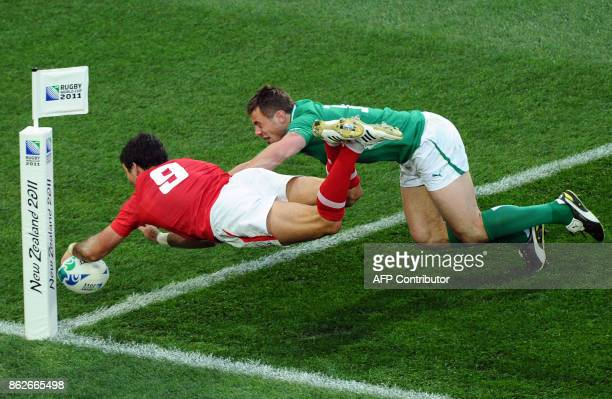 Wales' scrumhalf Mike Phillips scores a try infront of Ireland's right wing Tommy Bowe during the 2011 Rugby World Cup quarterfinal match Ireland vs...