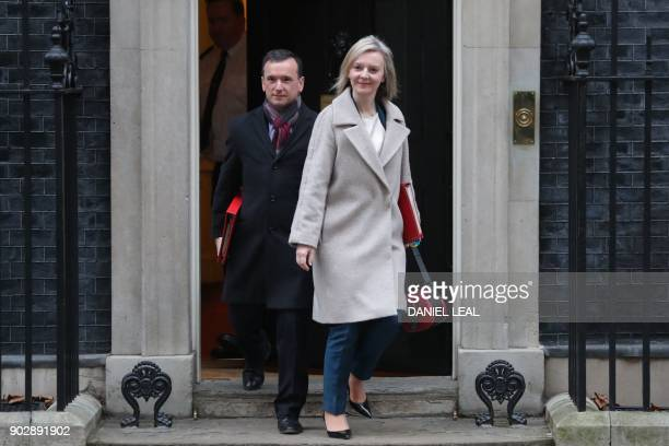 Wales Secretary Alun Cairns and Britain's Chief Secretary to the Treasury Liz Truss leaves 10 Downing street in central London after the first...