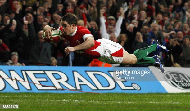 Wales' Shane Williams scores a try against Australia during the International friendly rugby match at the Millennium Stadium in Cardiff Wales on...