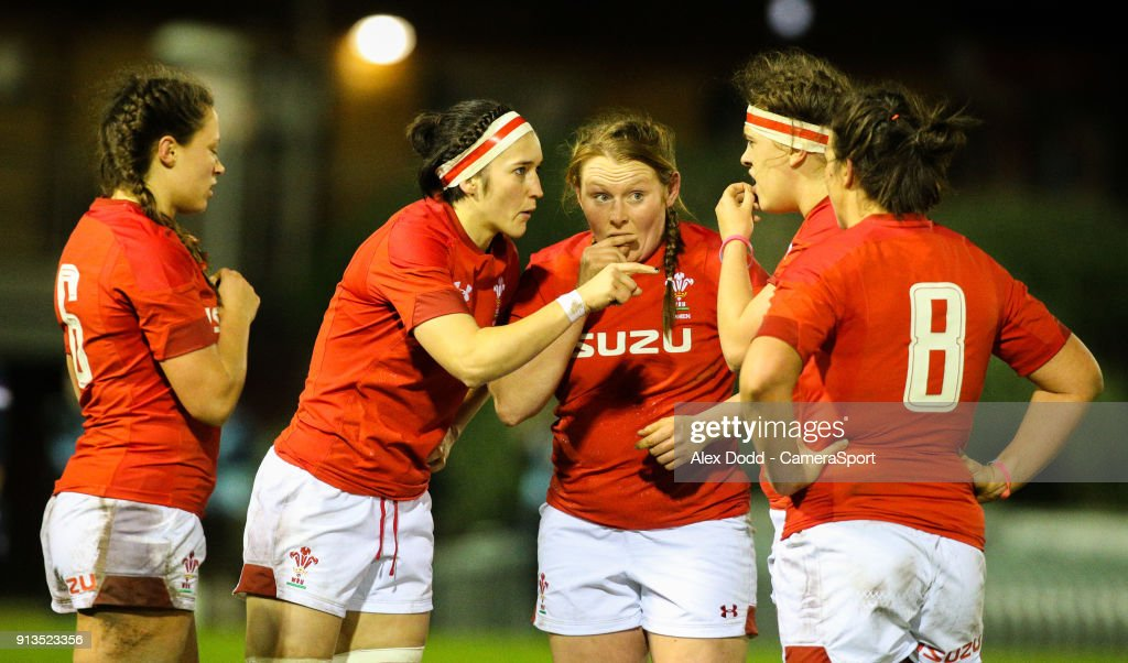 Wales' Siwan Lillicrap, Alisha Butchers, Caryl Thomas, Natalia John and Mel Clay share a word during a break in play during the Women's Six Nations Championships Round 1 match between Wales Women and Scotland Women at Eirias Stadium on February 2, 2018 in Colwyn Bay, Wales.