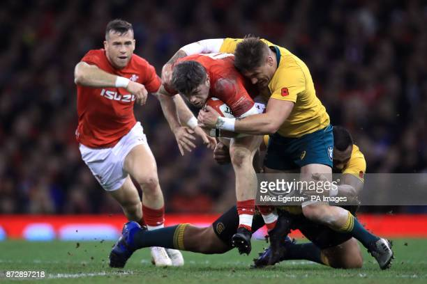 Wales' Steffan Evans is tackled by Australia's Tevita Kuridrani and Sean McMahon during the Autumn International at the Principality Stadium Cardiff