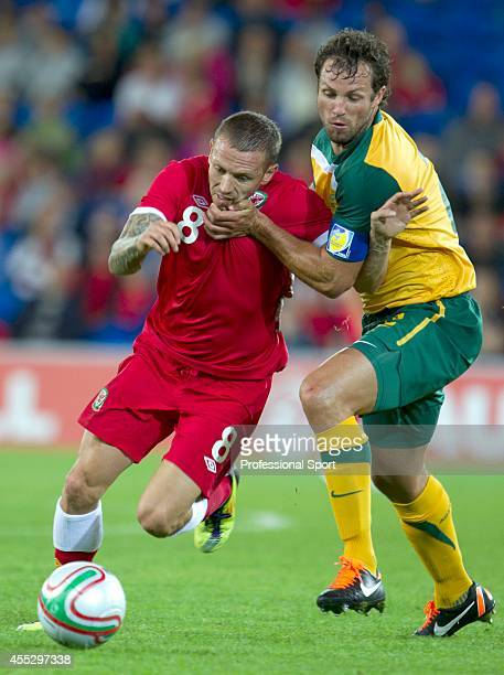 Wales striker Craig Bellamy is challenged by the captain of Australia, Lucas Neill, during the International Friendly match between Wales and...