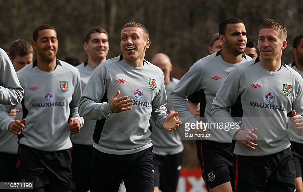 Wales striker Craig Bellamy shares a joke with team mates during Wales training at the Vale ahead of their UEFA EURO 2012 qualifier against England...
