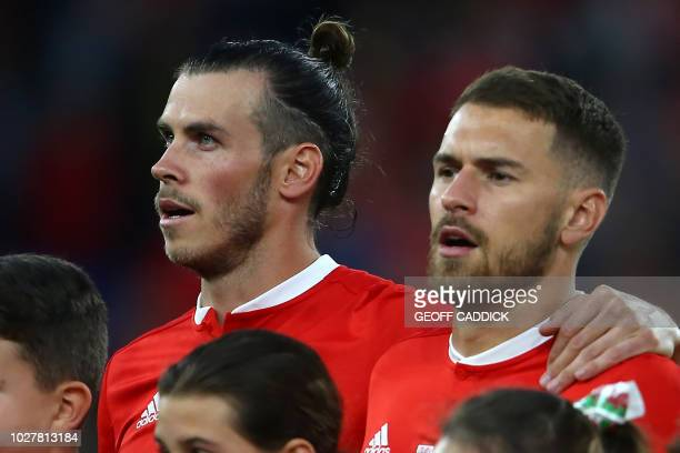 Wales' striker Gareth Bale and Wales' midfielder Aaron Ramsey sing the National Anthem ahead of the UEFA Nations League football match between Wales...