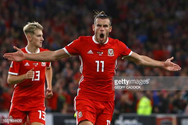 TOPSHOT Wales' striker Gareth Bale celebrates after scoring their second goal during the UEFA Nations League football match between Wales and...