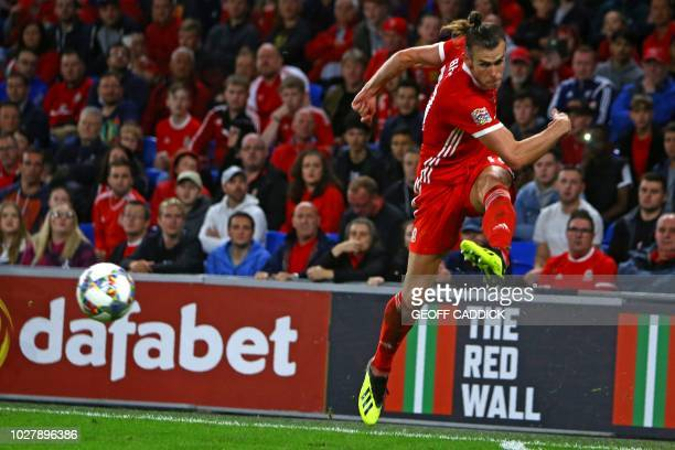 Wales' striker Gareth Bale crosses the ball during the UEFA Nations League football match between Wales and Republic of Ireland at Cardiff City...