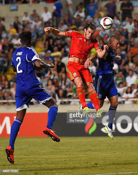 Wales striker Gareth Bale heads the opening goal during the UEFA EURO 2016 Qualifier between Cyprus and Wales at GPS Stadium on September 3 2015 in...