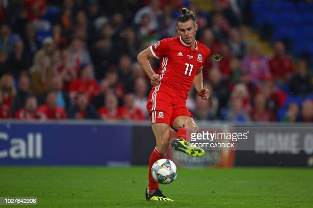 Wales' striker Gareth Bale passes the ball during the UEFA Nations League football match between Wales and Republic of Ireland at Cardiff City...