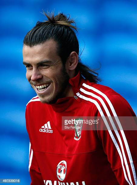 Wales striker Gareth Bale raises a smile during Wales trsaining ahead of the match against Andorra at Cardiff City stadium on October 12 2015 in...