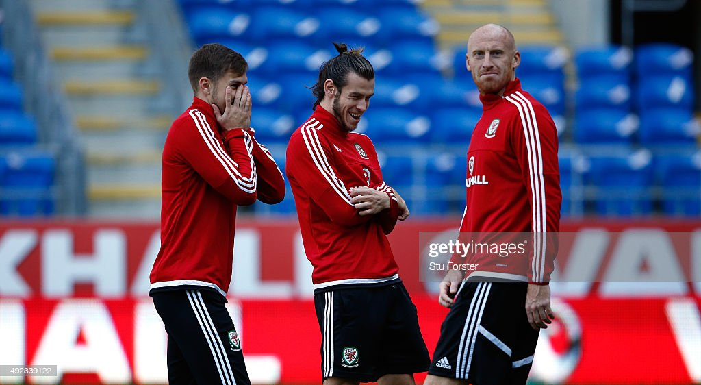 Wales striker Gareth Bale raises a smile with team mates Aaron Ramsey (l) and James Collins (r) during Wales training ahead of their match against Andorra at Cardiff City stadium on October 12, 2015 in Cardiff, United Kingdom.