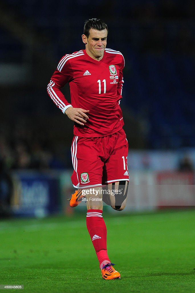 Wales striker Gareth Bale reacts after taking a knock during the International Friendly match between Wales and Finland at Cardiff City Stadium on November 16, 2013 in Cardiff, Wales.