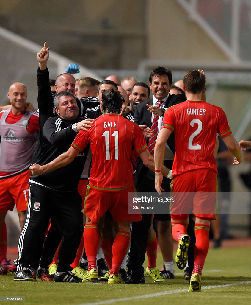 Wales striker Gareth Bale runs over to the bench to celebrate after scoring the opening goal during the UEFA EURO 2016 Qualifier between Cyprus and Wales at GPS Stadium on September 3, 2015 in Nicosia, Cyprus.
