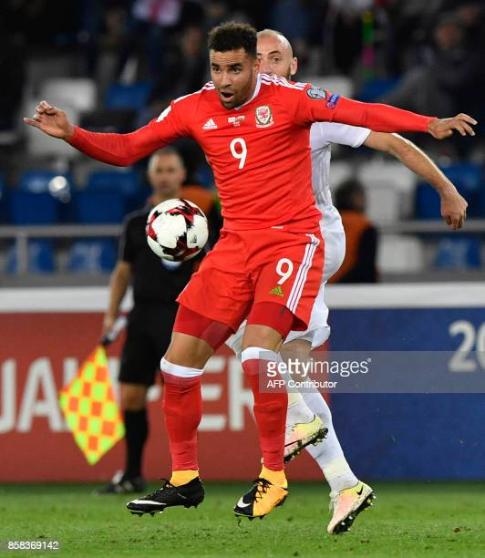 Wales' striker Hal RobsonKanu and Georgia's midfielder Valeri Gvilia vie for the ball during the FIFA World Cup 2018 qualification football match...