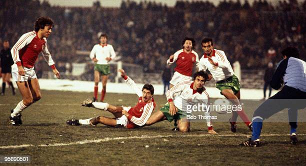 Wales striker Ian Rush falls to the ground but still manages to take a shot at the Bulgarian goal during their European Championship Qualifying match...