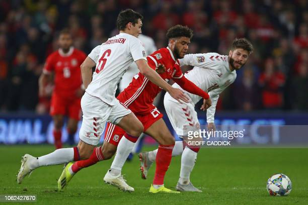 Wales' striker Tyler Roberts vies with Denmark's defender Andreas Christensen and Denmark's midfielder Lasse Schone during the UEFA Nations League...
