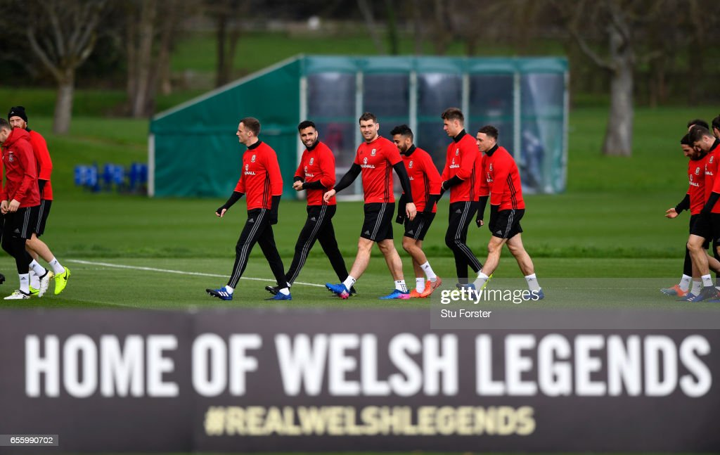 Wales strikers Hal Robson Kanu (centre left) and Sam Vokes (c) make thie way to training with team mates during a Wales Open Training session ahead of their World Cup Qualifier against the Republic of Ireland at the Vale Hotel on March 21, 2017 in Cardiff, Wales.