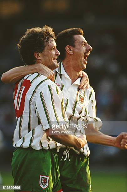 Wales strikers Ian Rush and Mark Hughes celebrate after Hughes had opened the scoring in a match against Czechoslovakia in Ostrava on April 28 1993